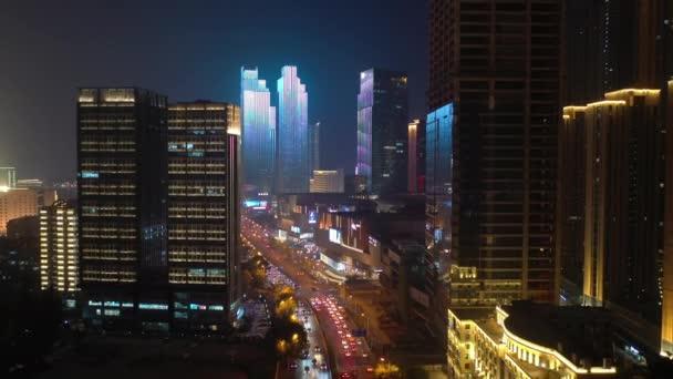 night time illumination show qingdao city downtown aerial panorama 4k china