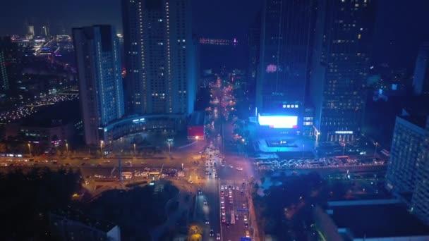 night time illumination qingdao city traffic aerial panorama 4k china