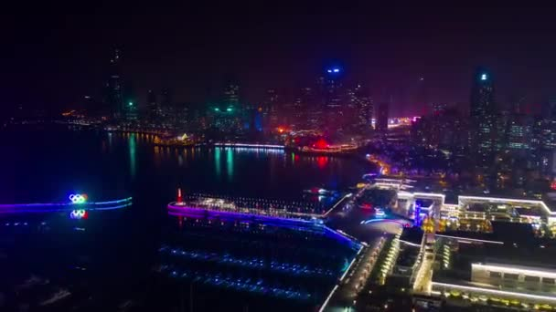 night time illumination qingdao city downtown aerial timelapse panorama 4k china