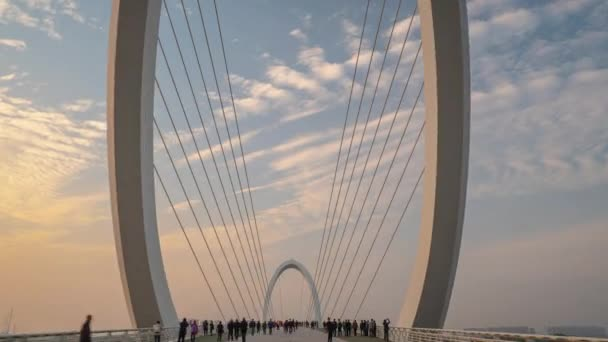 sunset time nanjing city famous international youth cultural center pedestrian riverside bridge aerial panorama 4k china