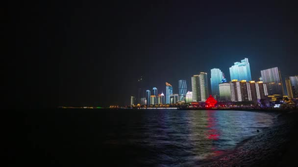 night time illumination qingdao city downtown aerial timelapse panorama 4k china