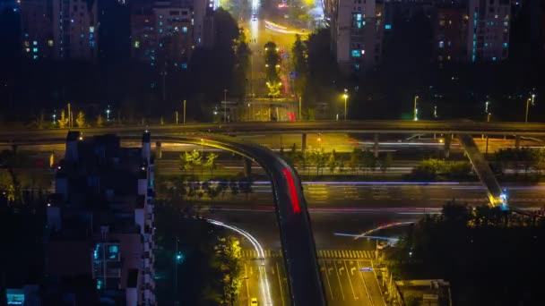 Night time illuminated Chengdu city downtown aerial traffic panorama 4k timelapse china