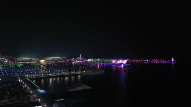 slunečný den Qingdao město slavné v centru olympijského zálivu maják letecké panorama 4k porcelán