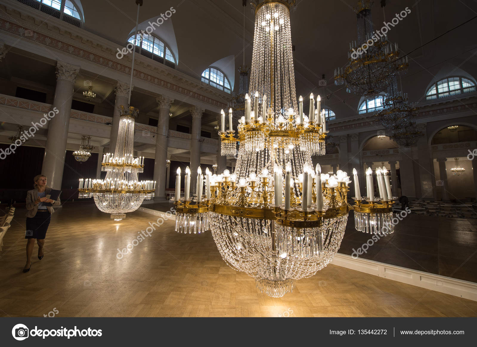 Crystal chandeliers in the st petersburg philharmonic stock saint petersburg russia september 6 2016 huge crystal chandeliers in the large concert hall of the state philharmonic tchaikovsky lowered to the floor aloadofball Images