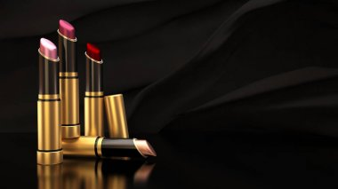 Lipstick on a background of black cloth flying. The tube, bottle, style, makeup, lips, beauty, make-up, facials. Cosmetics.