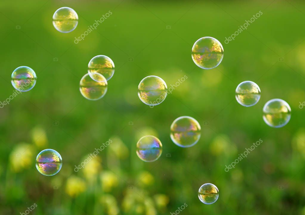 fancy elegant background with shiny soap bubbles flying over a f