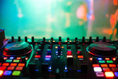 Photo remote mixer the DJ in nightclub at party for professional music control