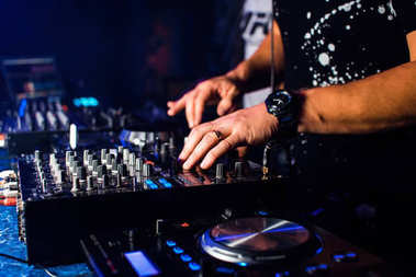 DJ mix music in a professional music boards and equipment