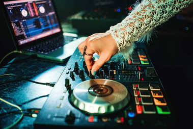 hand girl DJ with make-up and ring mixing music