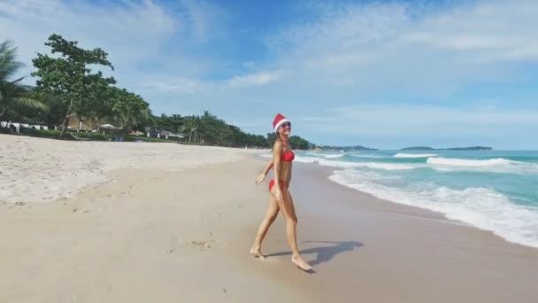 Beautiful Caucasian Christmas Woman In Santa Hat And Red Bikini