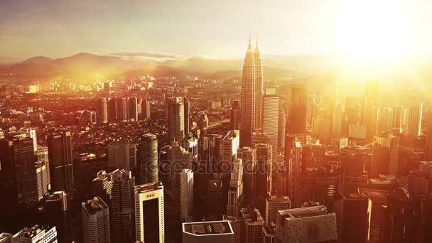 Orange sunrise. Aerial view of Kuala Lumpur city in Malaysia capital, tall buildings. Cinematic video of skyscrapers in big City.