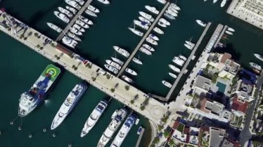 Aerial view on yacht club. White boats are in blue sea water.