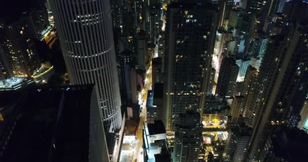 AERIAL. Night view over the central Hong Kong Skyline. Skyscrapers are densely crowded on Hong Kong Island.