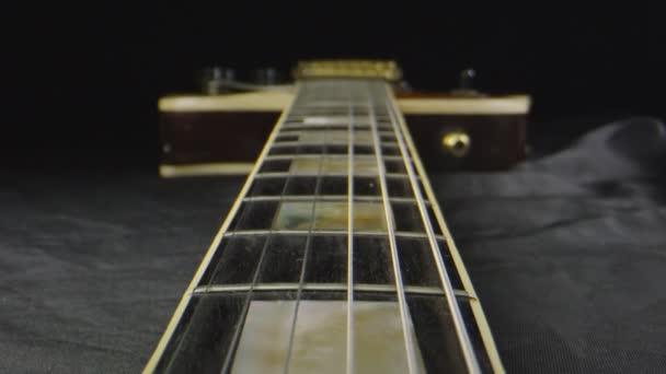 Macro shot through a laid down electric guitar
