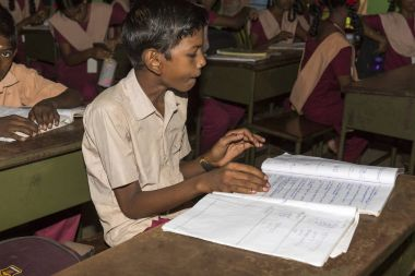 Documentary editorial image. Unidentified school children study in classroom at government public school.