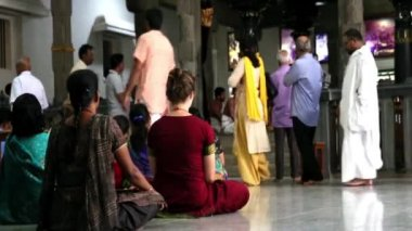 ASHRAM OF SRI RAMANA MAHARSHI, THIRUVANNAMALAI, TAMILNADU, INDIA - MARCH circa, 2018. Ramanasramam. Footgae, video of visitors and devotees sitting on the floor attend pooja and mantra chanting in the morning.