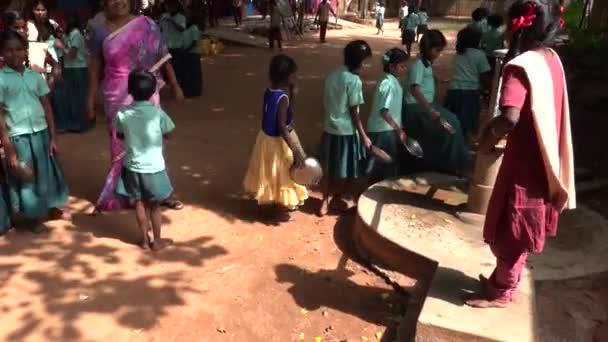 PUDUCHERY, INDIA  DECEMBER CIRCA, 2018. Cute unidentified children with uniforms in government elementary school waiting to clean their plate for lunch at canteen