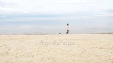 sand therapy. the child plays with the sand. Toys in the sand of the sea