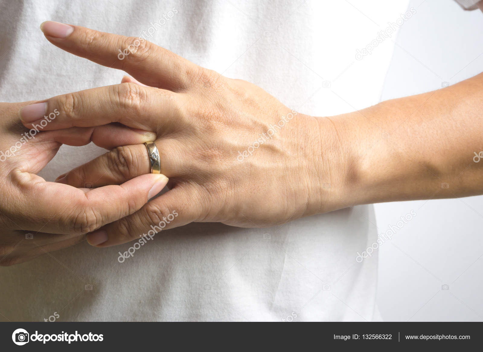 Man take off his wedding ring Stock Photo BonNontawat 132566322