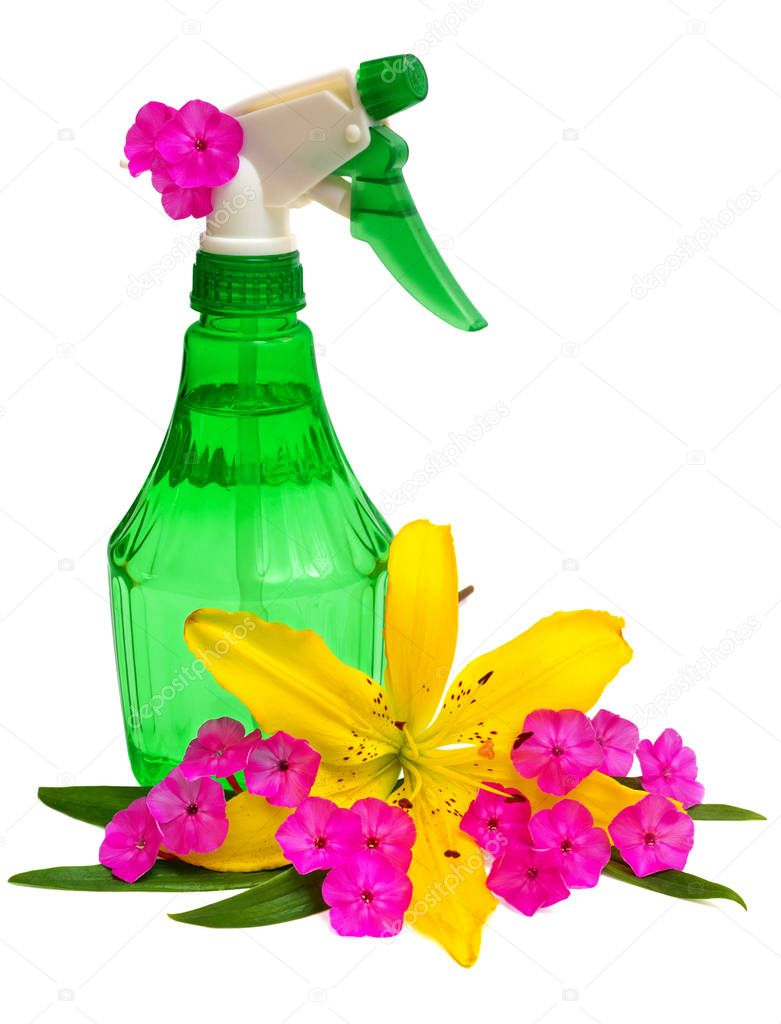 Bottle of water spray flowers decorated with flowers lilies and phlox