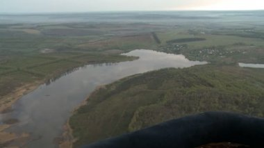Fine aerial view to lake and field