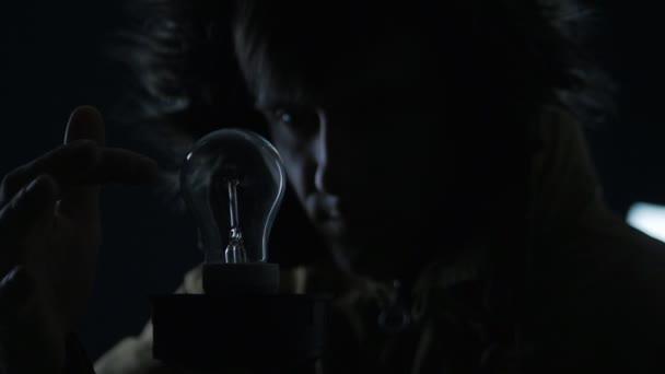 Man Lights A Lamp In A Dark Place U2014 Stock Video