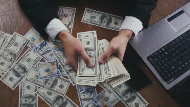 Close up hands of a businessman counting money sitting at table in office. Concept of salary or profit.
