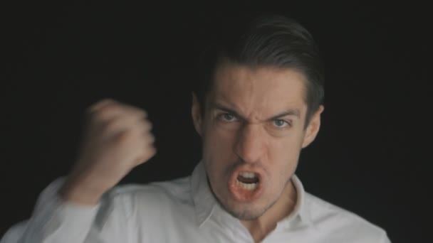 Portrait of a young man angry businessman screaming with fury and threatened violence