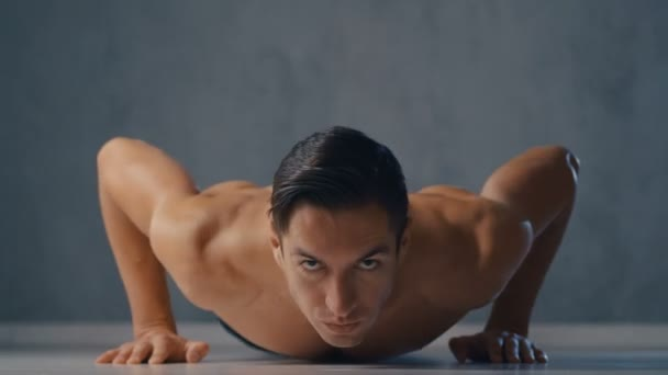 Young Athletic Skinny Man with a Bare Torso Performs Pushups at home. Male Workout Fitness Training. Healthy lifestyle.