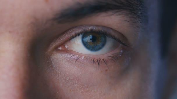 close-up macro blue eye opening human iris