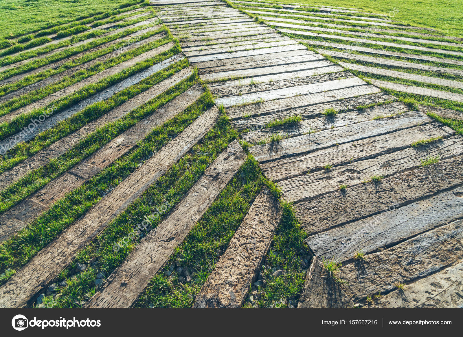 full frame shot of wooden walkway on grass — Stock Photo ...