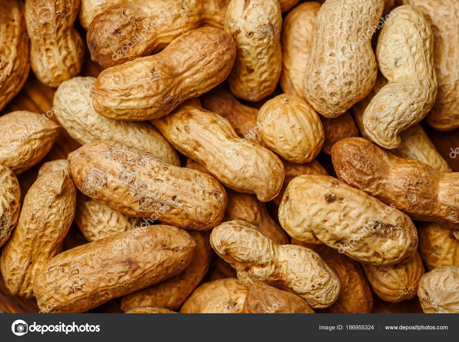 arachide en une texture de la coque. fond de nourriture d'arachides