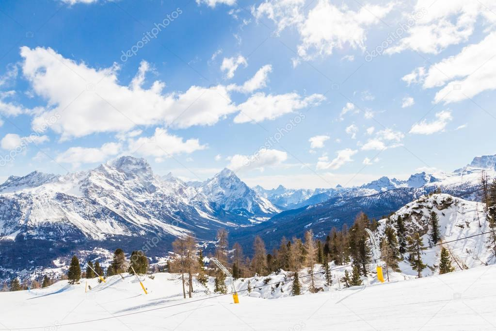 Wide ski track with beautiful mighty mountain range view on the background