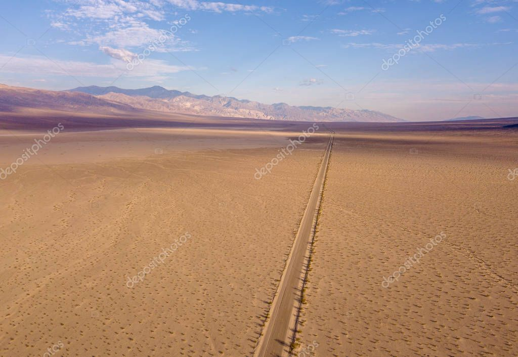 Endless road to the horizon through the Death valley
