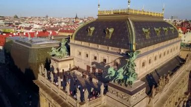 Beautiful aerial view of the Prague National Theatre from above flying away. Amazing building landscape footage.