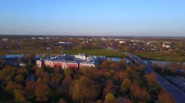 Amazing sunset time view from above on the LLU castle of Jelgava. Aerial city view.