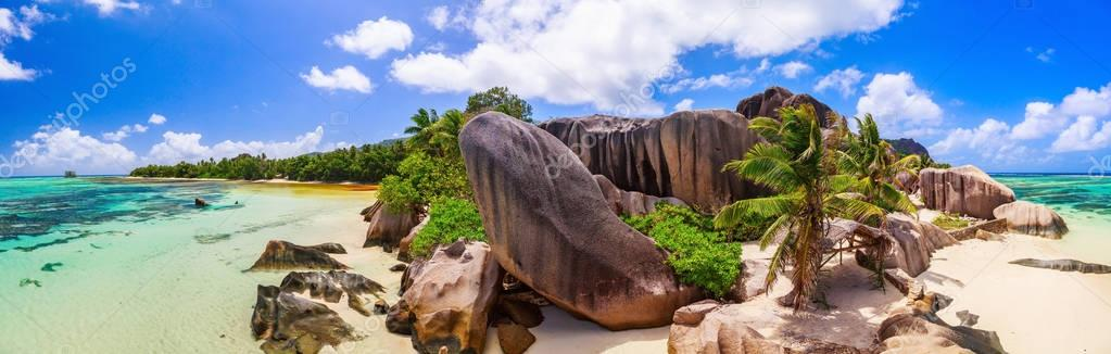 Unique huge rock on the beautiful paradise beach by the Indian ocean on Seychelles.