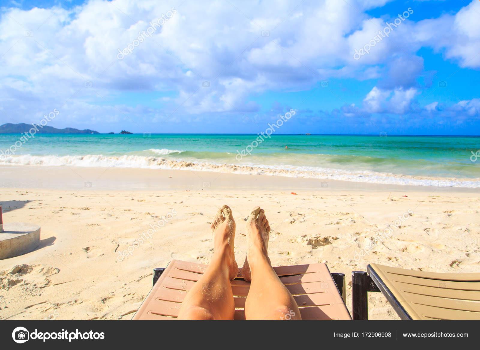 close young man feet relaxing beach sea background mauritius stock
