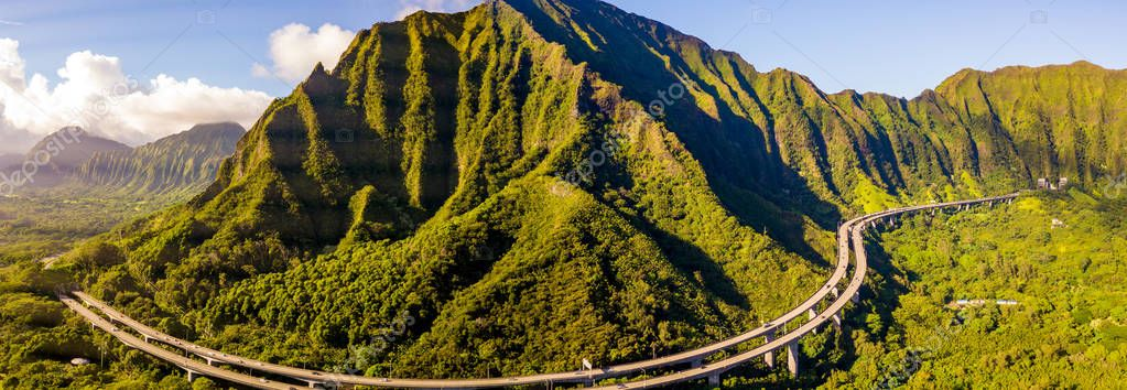 Gorgeous aerial view of the Oahu green mountains view by the Ho'omaluhia Botanical Garden in Kaneohe. Mountains with famous stairs to heaven or Haiku stairs.