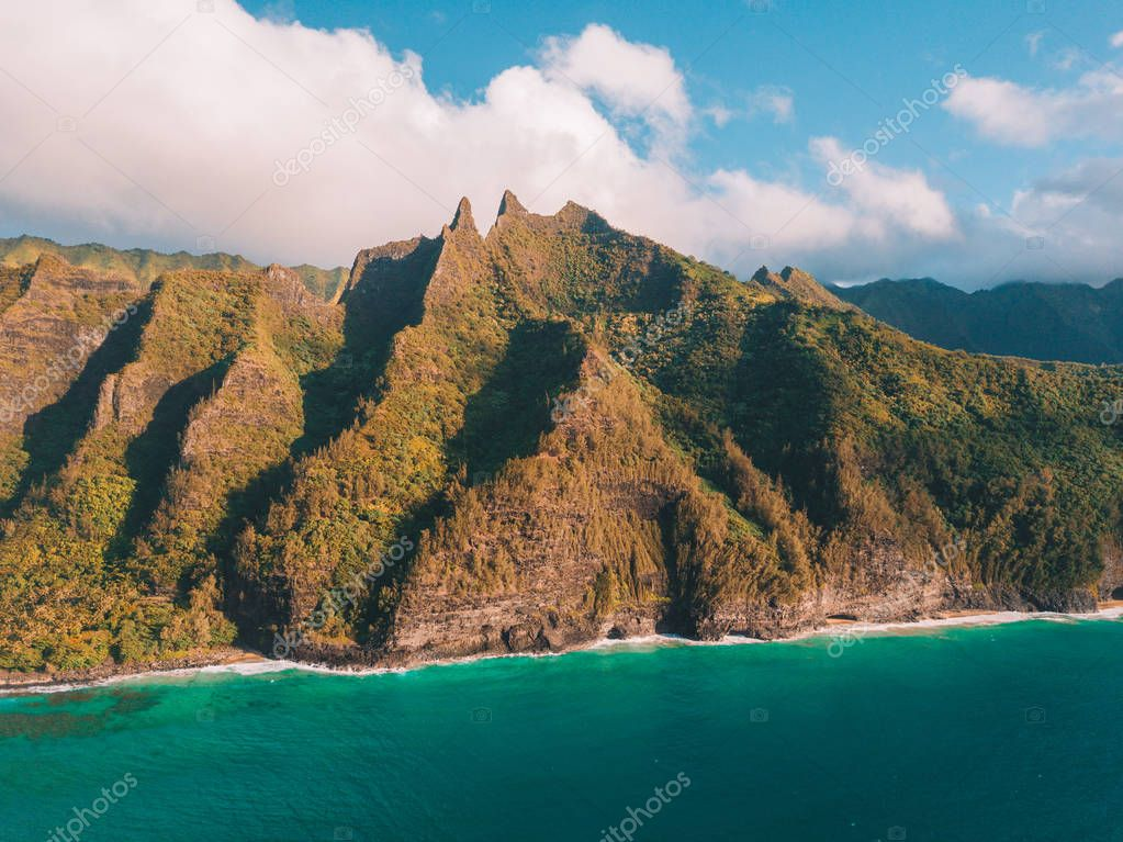 Amazing panoramic view of the Na Pali coastline cliffs from above. Aerial scene. Beautiful Hawaii islands. Paradise on earth.