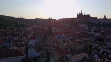 Amazing panoramic view of the Prague city from above during sunset with a castle of Prague on the horizon on the hill.