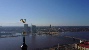 Amazing aerial view of the Riga city golden cock with Daugava river on the background.