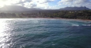 Amazing aerial view of the Hawaii nature, beac, Pacific ocean waves during sunset time. View on the beach at the Kauai island.