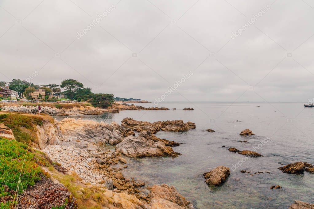 Beautiful coastline near Monterey town during cloudy weather and calm sea