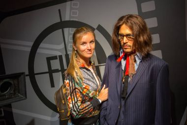 Girl standing by the Johnny Depp wax figure at Madame Tussauds in Sydney Australia as on 17 Jan 2017