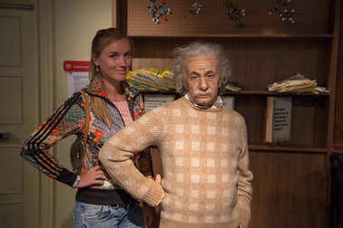 Girl sitting by the Albert Einstein wax figure at Madame Tussauds in Sydney Australia as on 17 Jan 2017