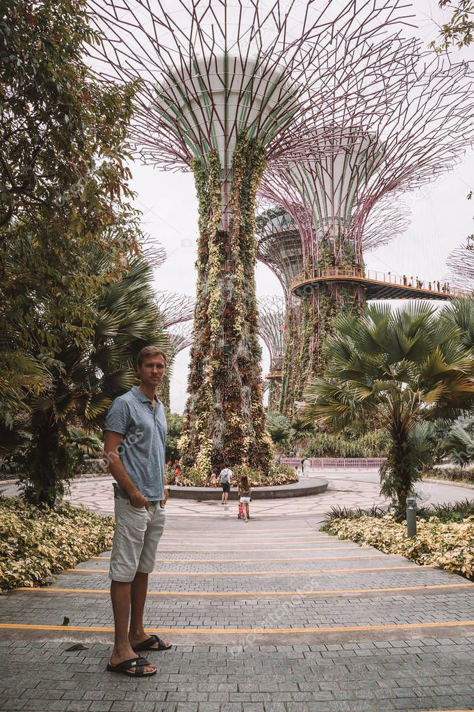 May 10, 2017. Young man walking around the amazing Gardens by the bay in Singapore, Asia near Marina Sands hotel.