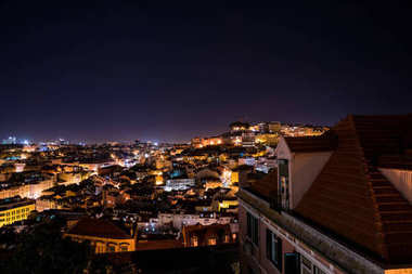 Beautiful aerial night view of the Lisbon city from above.