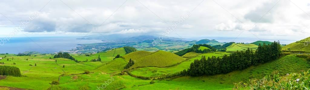 Beautiful nature view on Azores with small villages, tows, green nature fields. Amazing Azores.