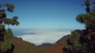 Beautiful aerial view of the nature in Spain on the island of Tenerife. Mountains above the clouds view.